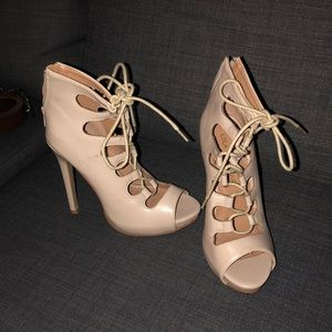 Nude pair of lace up heels